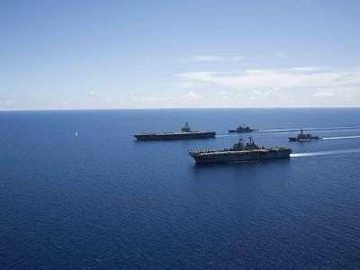 美航母进入南海 立刻调动大批战舰来反击